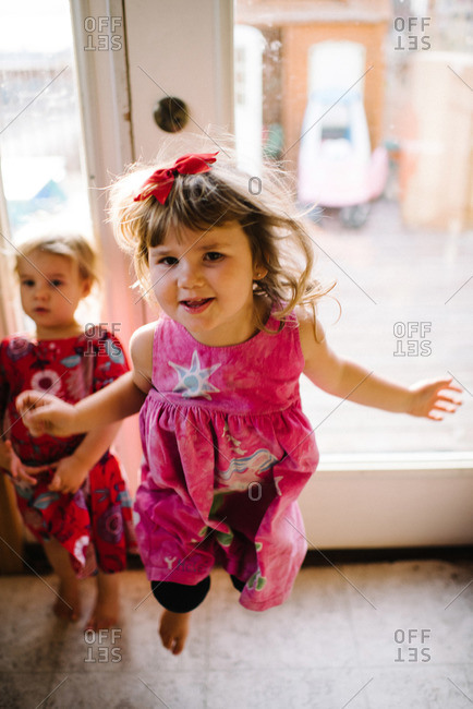 Girl in a midair leap in a house
