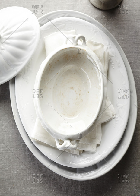 Vintage white serving dishes in a pile