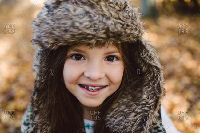 Portrait of a little girl in a fuzzy bomber hat