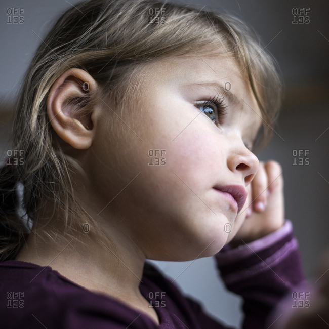 Portrait of a pensive toddler girl