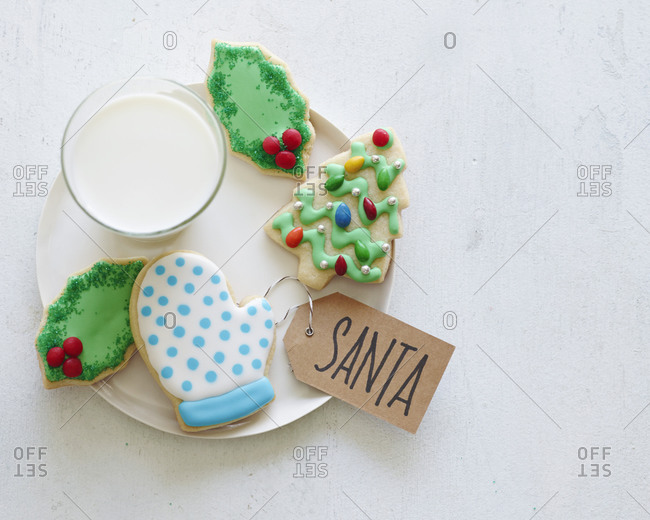 Christmas cookies on a plate with milk for Santa