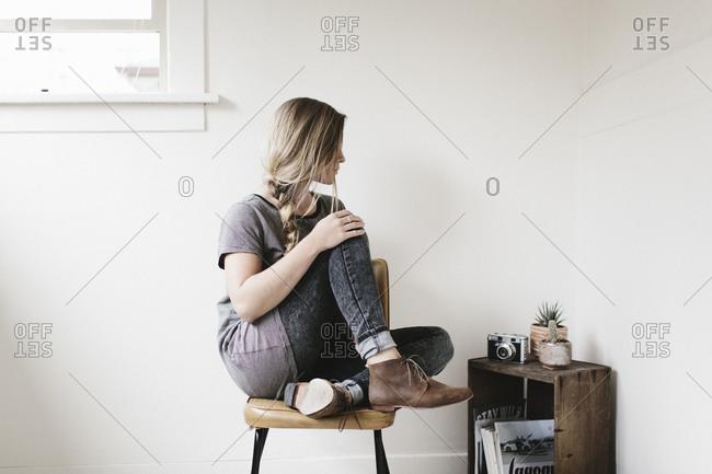 Woman in corner of sparse room