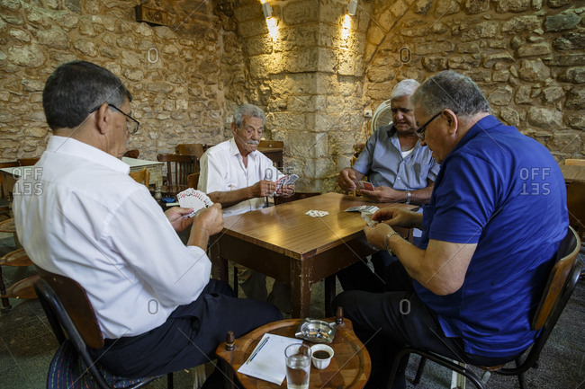 Nazareth, Israel - September 29, 2015: Four men playing cards at a caf� in Israel