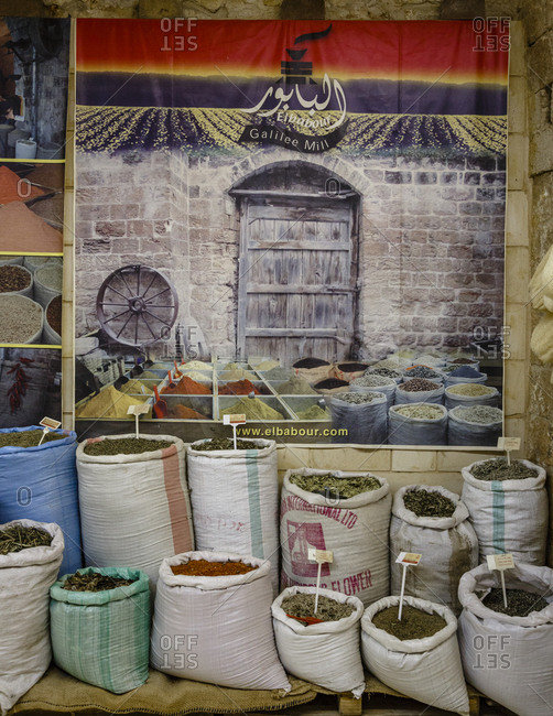 Nazareth, Israel - September 29, 2015: Poster of spice market and bags of spices for sale in a spice store