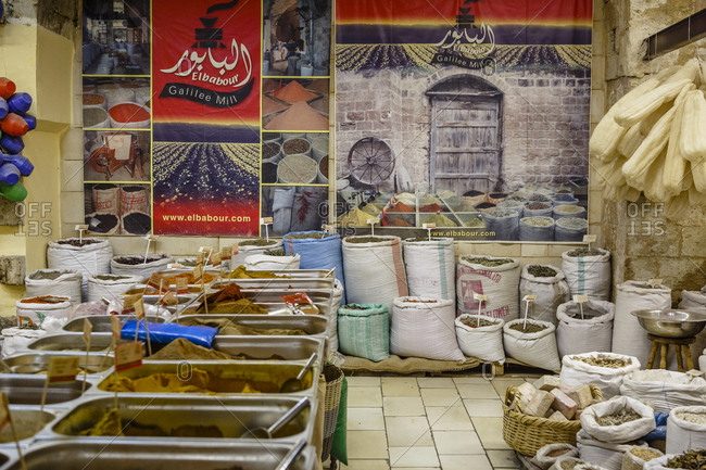 Nazareth, Israel - September 29, 2015: Bins and sacks of spices for sale in a spice shop, Israel