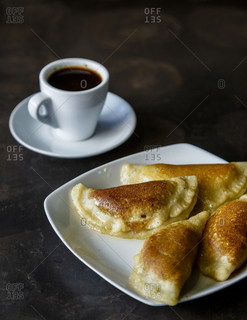 Honey drizzled over Katayef traditional Arab sweets and served with coffee