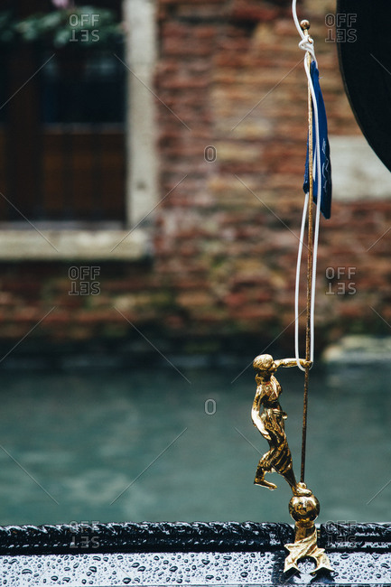 Rope attached to golden figurine in Venice