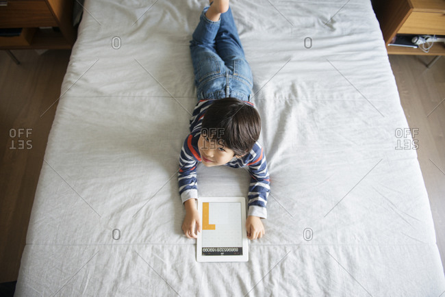 Boy using a smart tablet's calculator