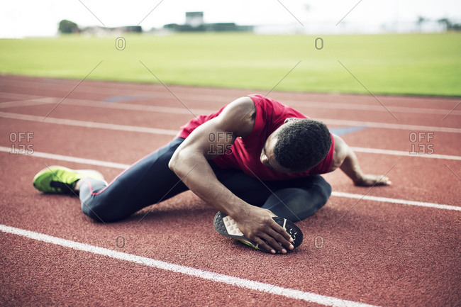 Man does stretches before running