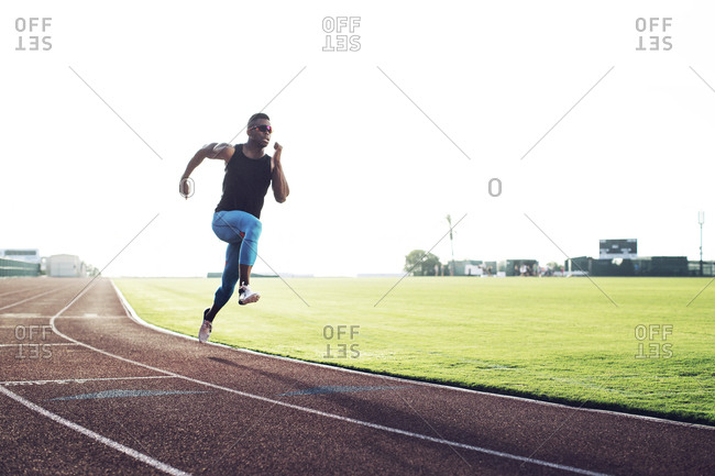 Man sprinting on a running track