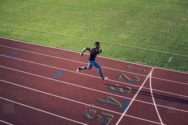 Runner sprinting down track
