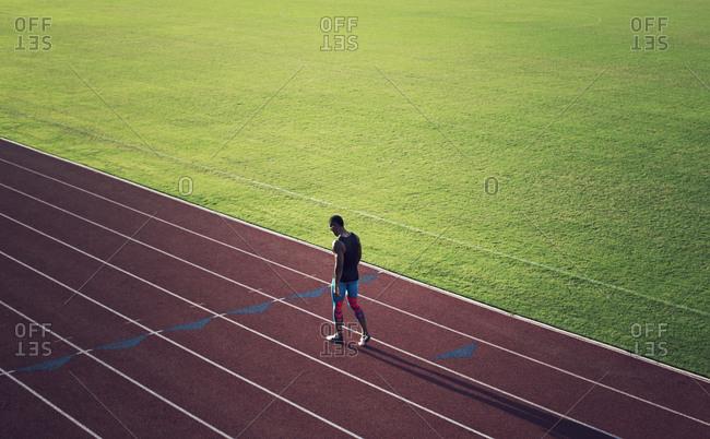 Runner walking on track