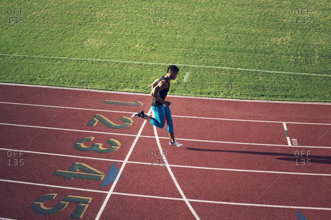 Runner crossing finish line on track
