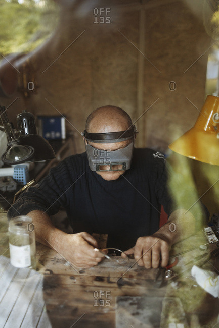 Senior craftsperson working in workshop