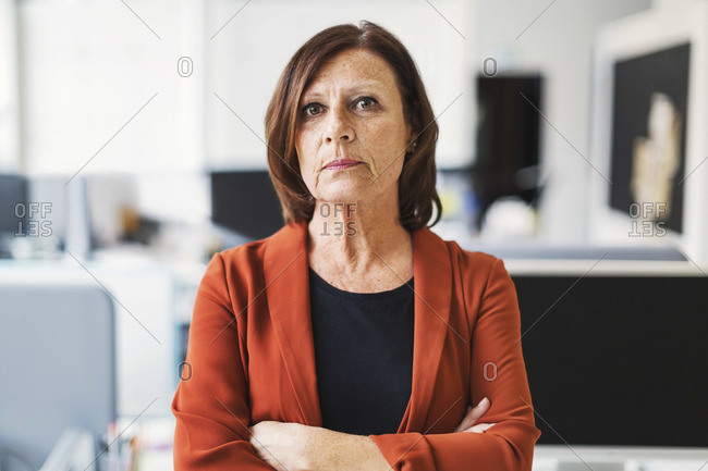 Portrait of businesswoman standing arms crossed in office