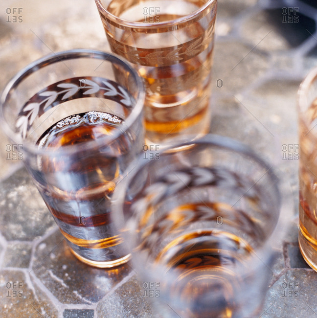 Close up of drink glasses containing alcohol