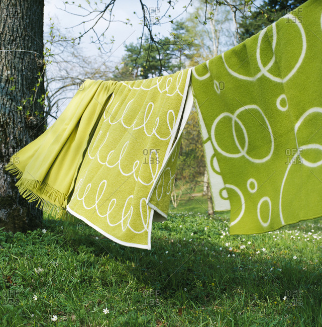 Green towels hanging to dry in garden