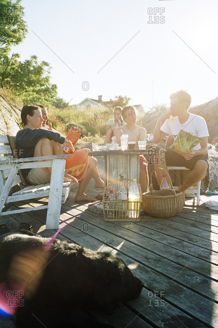 Five people eating outdoors