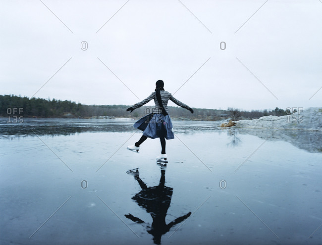 Woman ice skiing on a frozen lake
