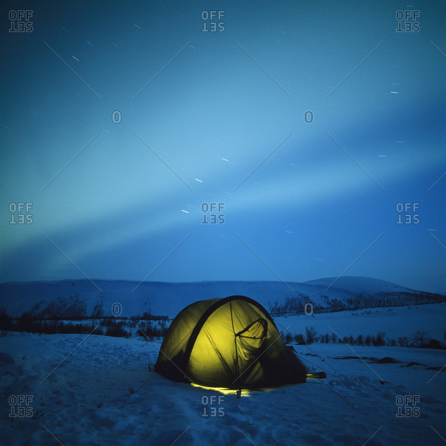 A tent under northern lights