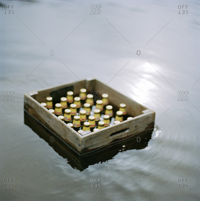 A beer crate is getting cold in a lake, Sweden