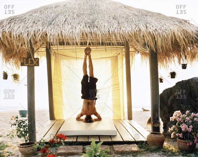 A Scandinavian woman performing yoga, Thailand