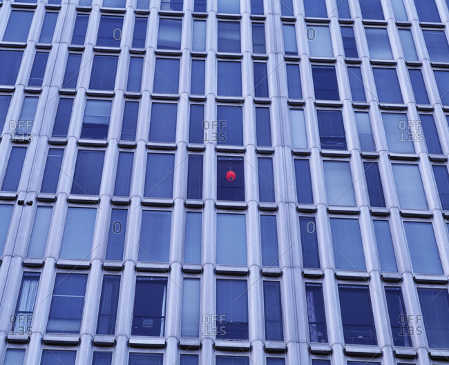 Red ball light hanging in building