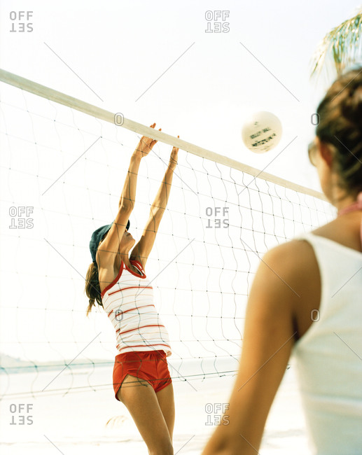 Scandinavian woman playing beach volleyball
