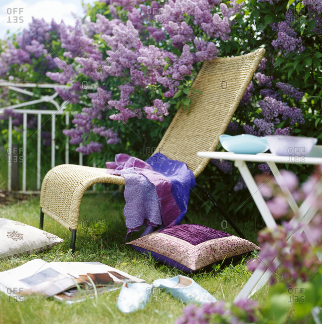 Outdoor furniture in a flowering garden, Sweden