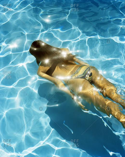 A Scandinavian woman swimming in a pool