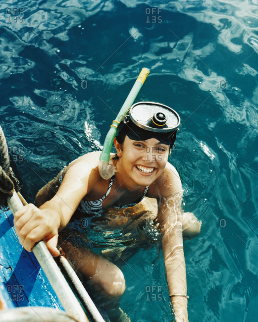 Portrait of a woman wearing goggles and snorkel in the sea
