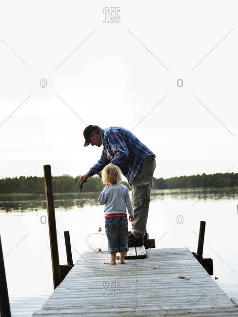 Grandfather going fishing with his grandchild, Sweden