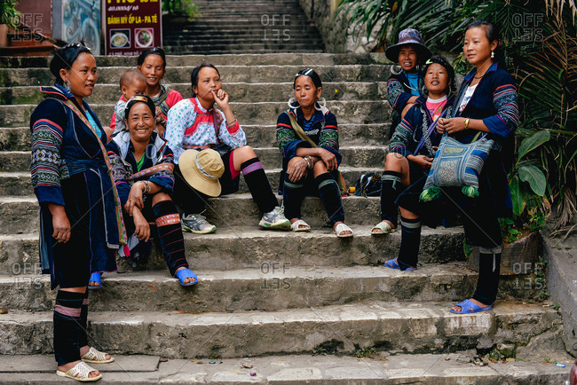 Sapa, Vietnam - July 13, 2015: Women await the chance to sell souvenirs to tourists