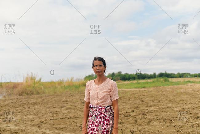 Bagan, Myanmar - July 19, 2015: A woman on the trek to her village near Bagan