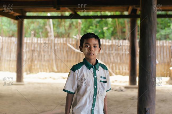 Bagan, Myanmar - July 19, 2015: Portrait of a boy at a school in a small village near Bagan