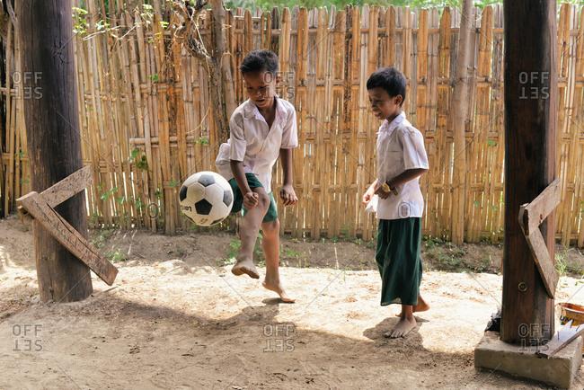 Bagan, Myanmar  - July 19, 2015: Children play at a school in a small village near Bagan