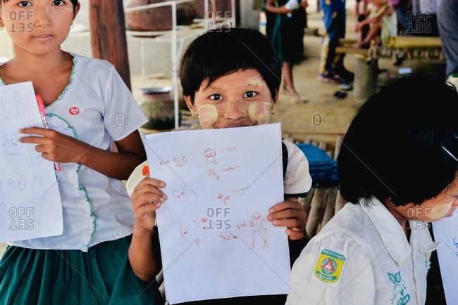 Bagan, Myanmar  - July 19, 2015: Children learn English at a school in a small village near Bagan