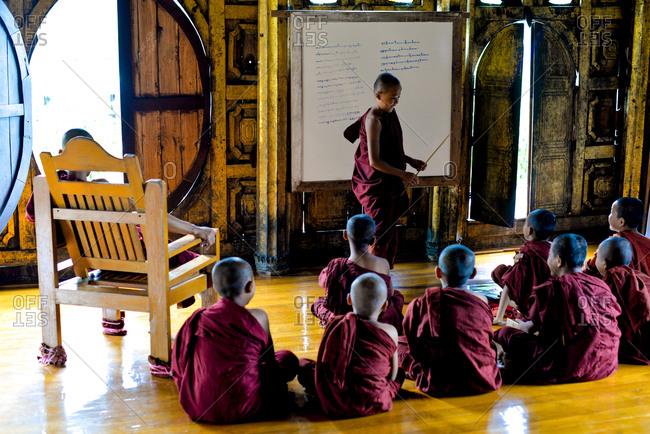 Nyaung Shwe, Myanmar - July 21, 2015: Resident monks learn the teachings of Buddhism at the Shwe Yan Pyay Monastery