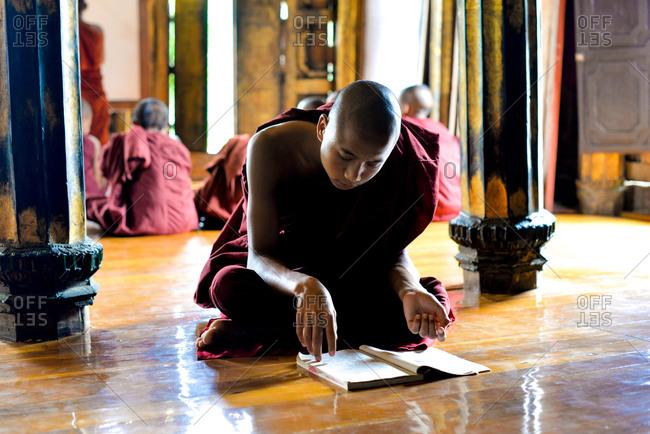 Nyaung Shwe, Myanmar - July 21, 2015: Resident monk learning Buddhism at the Shwe Yan Pyay Monastery