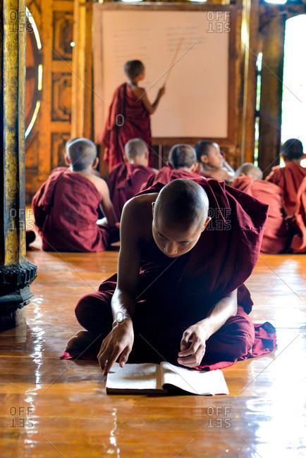 Nyaung Shwe, Myanmar - July 21, 2015: Resident monks learn Buddhist teachings at the Shwe Yan Pyay Monastery