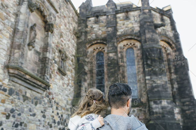 Father and daughter visiting Edinburgh Castle in Scotland