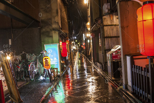 Rainy Japanese city street at night