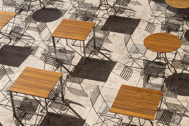 Outdoor dining area with metal chairs and wooden tables