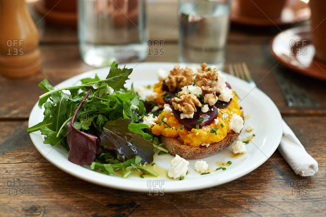 Butternut squash and walnuts on toast with a side salad