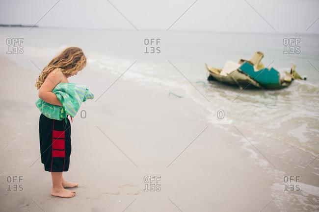 Little boy standing on the beach