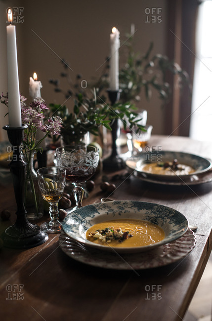Bowls of soup on a rustic decorated table