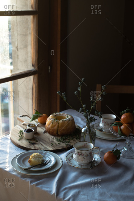 Miniature cake on a table decorated with oranges