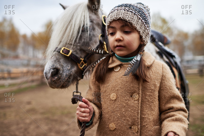 Miniature horse being led by a little girl