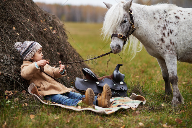 Young girl hanging out with her miniature horse