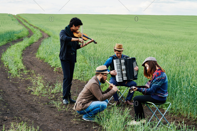 Group of musicians playing in a farm field